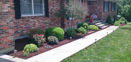 Landscaping installed by Stanaway Farms in front of a building in Columbia, MO.